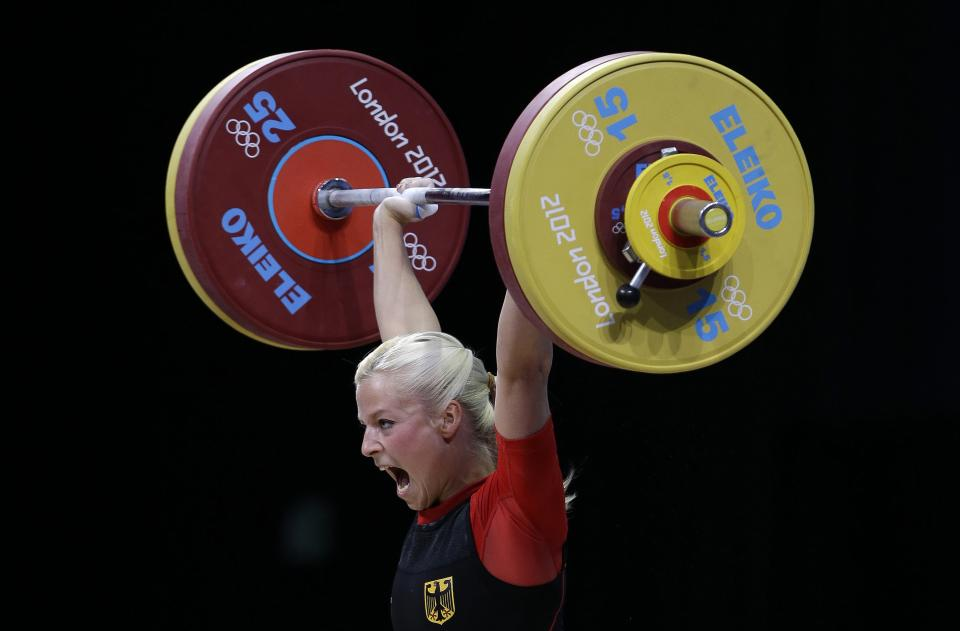 Germany's Julia Rohde lifts during the women's 53-kg, group B, weightlifting competition at the 2012 Summer Olympics, Sunday, July 29, 2012, in London. (AP Photo/Hassan Ammar)