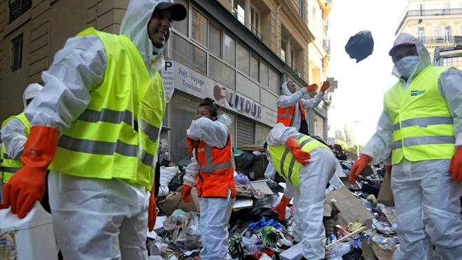 "Garbage collectors began tackling Marseille's reeking mounds of trash in the center of Marseille, southern France, Tuesday, Oct. 26, 2010. Striking garbage collectors in Marseille faced 9,000 tons of garbage that have piled up in the streets in the last two weeks. The FO union voted Monday evening to end the protest out of concerns over ""hygiene and safety."" City authorities said it would take four to five days before France's second-largest city starts looking, and smelling, like itself. (AP Photo/Laurent Cipriani)"