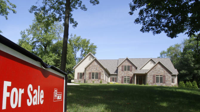 In this Aug. 22, 2011 photo, a new home is shown for sale, in Pepper Pike, Ohio. Sales of new homes fell to a six-month low in August. The fourth straight monthly decline during the peak buying season suggests the housing market is years away from a recovery.(AP Photo/Tony Dejak)