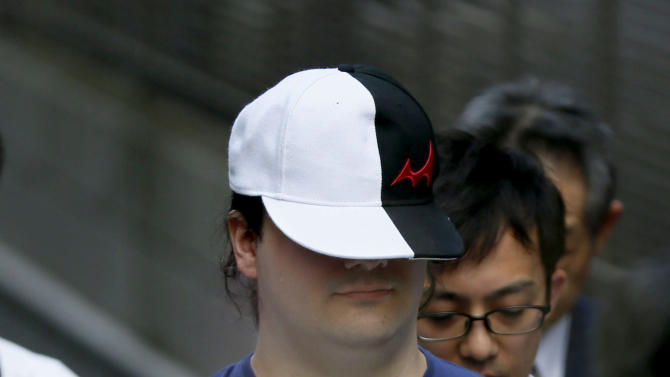 Japan police arrest Mark Karpeles, the Mt. Gox CEO on Saturday, Aug. 1, 2015, in Tokyo. Karpeles, was arrested Saturday on suspicion of inflating his cash account by $1 million. Karpeles' lawyer told the Kyodo News service that his client denies wrongdoing. (AP Photo/Kyodo News) JAPAN OUT, MANDATORY CREDIT
