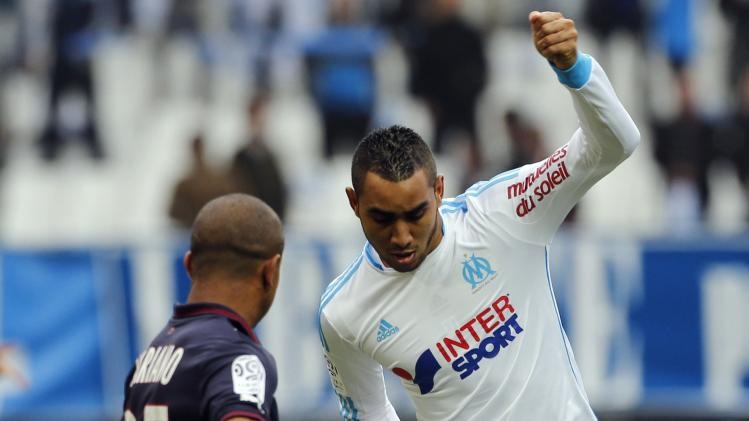 Olympique Marseille's Payet challenges Bordeaux's Ferreira during their French Ligue 1 soccer match at the Velodrome stadium in Marseille