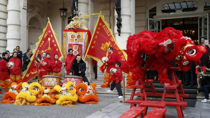 Members of the Pak Mei DE Lao Wei San Kung-Fu school perform to celebrate Chinese New Year in front of the Shangri-La hotel in Paris