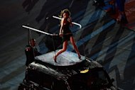 British singer Victoria Beckham of The Spice Girls band performs on top of a London taxi during the closing ceremony of the 2012 London Olympic Games at the Olympic stadium in London