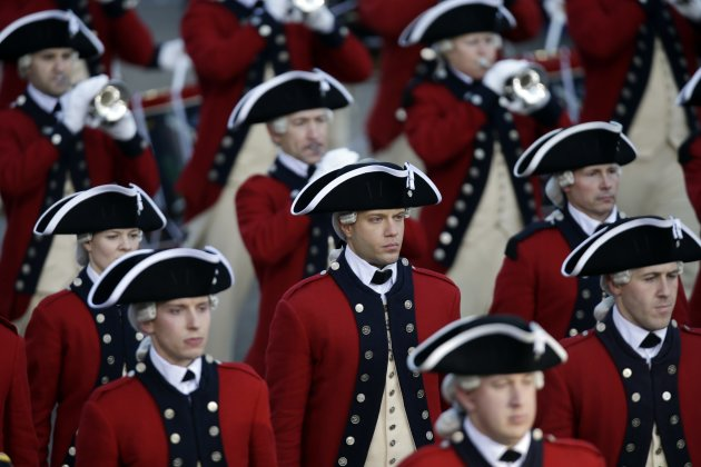 The Army&#39;s Old Guard Fife and Drum Corps walks down Pennsylvania Avenue en route to the White House, Monday, Jan. 21, 2013, in Washington. Thousands marched during the 57th Presidential Inauguration parade after the ceremonial swearing-in of President Barack Obama. (AP Photo/Charlie Neibergall)