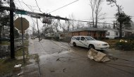 Areas of Hattiesburg, Miss., are still without power Monday, Feb. 11, 2013 following Sunday's afternoon tornado that caused extensive damage throughout the South Mississippi college town. Transformers, power poles and many power lines are down along the areas hit by the tornado. (AP Photo/Rogelio V. Solis)