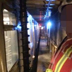 Construction crew nearly drills into top of moving subway train