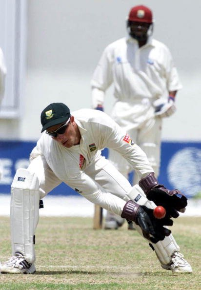 12  Mar 2001: Mark Boucher stoops low to take a catch during the South Africa v West Indies 1st Test  Bourda Stadium  Georgetown Guayana West Indies  Day 4. Photo Credit:  Duif du Toit/Touchline Photo
