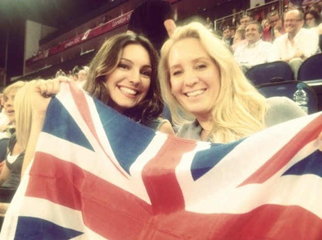 Celebrity photos: This week has been all about the Olympics, and Kelly Brook got into the spirit, taking a friend and a massive union jack flag along to the games. She even tweeted that the female bea