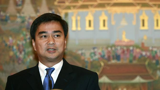 FILE - In this July 19, 2011 file photo, outgoing Thai Prime Minister Abhisit Vejjajiva talks to reporters during a news conference on Thailand's dispute with Cambodia over an ancient temple at Government House in Bangkok. Thai law enforcement authorities announced Thursday, Dec. 6, 2012, that they will file murder charges against Abhisit and his deputy in the first prosecutions of officials for their roles in a deadly 2010 crackdown on anti-government protests. (AP Photo/Apichart Weerawong, File)