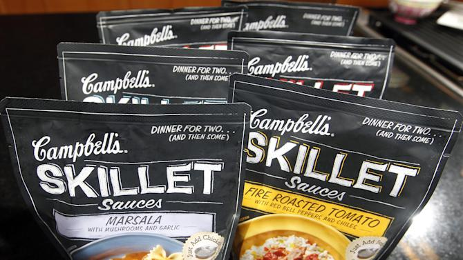 In this Friday, Aug. 24, 2012 photo, Campbell's new Skillet sauces are displayed at the Campbell Soup Company headquarters in Camden, N.J. As more people try their hand at mimicking sophisticated recipes from cooking shows and blogs, food companies are rolling out meal kits and starters that make amateur chefs feel like Emeril Lagasse or Rachael Ray in the kitchen. (AP Photo/Mel Evans)
