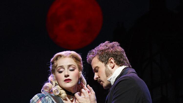 "This theater image released by Boneau-Bryan/Brown shows Betsy Wolfe, left, and Will Chase in a scene from ""The Mystery of Edwin Drood,"" playing at the Roundabout Theatre Company at Studio 54 in New York. (AP Photo/Boneau-Bryan/Brown, Joan Marcus)"