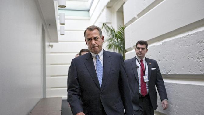 House Speaker John Boehner of Ohio walks to a closed-door Republican strategy session, Wednesday, Dec. 5, 2012, on Capitol Hill in Washington. (AP Photo/J. Scott Applewhite)