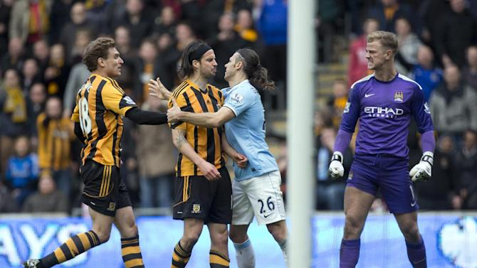 In this photo made available March 20 2014, Hull City's Georgre Boyd, centre left, is restrained by Martin Demichelis after a clash with Manchester City's goalkeeper Joe Hart, right, during their English Premier League soccer match at the KC Stadium, Hull, England, Saturday March 15, 2014. Boyd will serve an immediate three-match ban after a Football Association charge against him for spitting at Joe Hart was proven