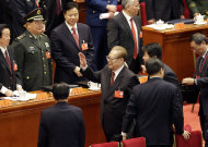 Former Chinese President Jiang Zemin, center, waves as he leaves after the opening session of the 18th Communist Party Congress held at the Great Hall of the People in Beijing, China, Thursday, Nov. 8, 2012. China's ruling Communist Party opened a congress Thursday to usher in a new group of younger leaders faced with the challenging tasks of righting a flagging economy and meeting public calls for better government. (AP Photo/Lee Jin-man)