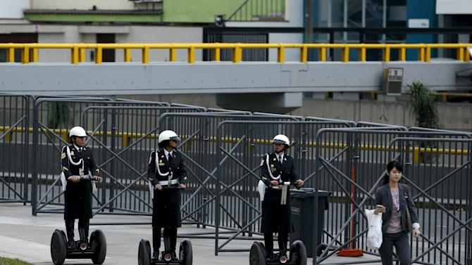 Peruvian policewomen ride segways to patrol the venues of the 2015 IMF/World Bank annual meetings event in Lima