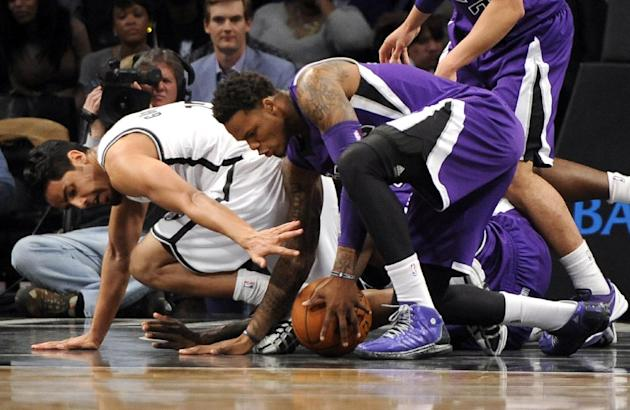 Brooklyn Nets' Jorge Gutierrez, left,  scrambles for a loose ball with Sacramento Kings shooting guard Ben McLemore  in the second half of an NBA basketball game on Sunday, March 9, 2014 at Barcla