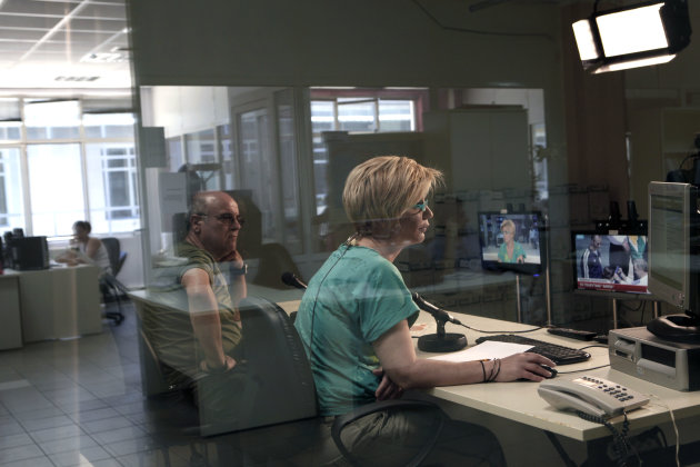 Journalists look on monitors inside a studio at Greek state television ERT headquarters in Athens, on Tuesday, June 18, 2013. State TV channels in Greece remained off-air Tuesday as the political stor