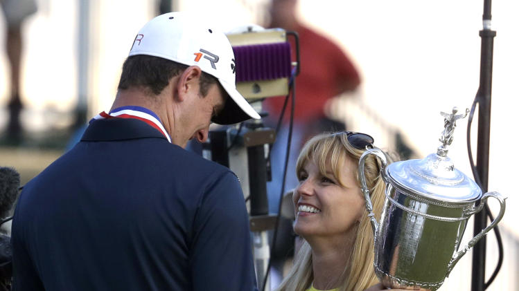Justin Rose, left, of England, celebrates with his wife Kate after winning the U.S. Open golf tournament at Merion Golf Club, Sunday, June 16, 2013, in Ardmore, Pa. (AP Photo/Gene J. Puskar)