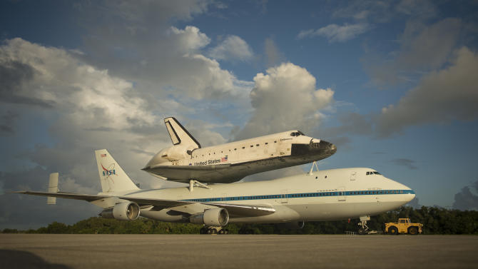 This photo provided by NASA shows space shuttle Endeavour atop NASA's Shuttle Carrier Aircraft, or SCA, at the Shuttle Landing Facility at NASA's Kennedy Space Center on Monday, Sept. 17, 2012 in Cape Canaveral, Fla. The beginning of Endeavour's final flight to California has been postponed because of weather along the flight route. NASA had planned for the 747 carrying the shuttle to take off from Kennedy Space Center on Monday.  (AP Photo/NASA, Bill Ingalls)
