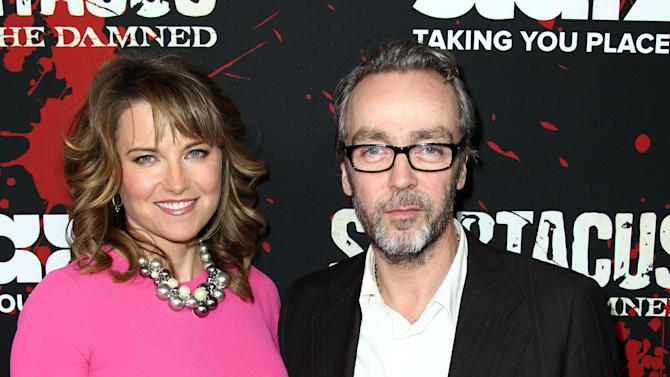 "Lucy Lawless, left, and John Hannah pose together at the premiere of ""Spartacus: War of the Damned"" on Tuesday, Jan. 22, 2013 in Los Angeles. ""Spartacus: War of the Damned"" premieres Friday, Jan. 25 at 9PM on STARZ. (Photo by Matt Sayles/Invision for STARZ/AP Images)"