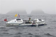British adventurer Sarah Outen arrives in Adak in the Aleutian Islands September 23, 2013 to become the first person to ever row solo from Japan to Alaska - a distance of 3,750 nautical miles. REUTERS/James Sebright/Handout via Reuters