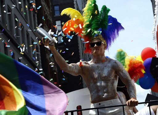 A marcher rides down 5th Avenue during the 2012 New York Gay Pride parade