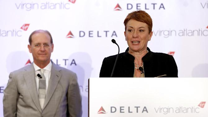 Virgin Atlantic CCO Julie Southern speaks while Delta Airlines CEO Richard Anderson listens during a news conference in New York, Tuesday, Dec. 11, 2012. Delta Air Lines said it will buy almost half of Virgin Atlantic for $360 million as it tries to catch up to rivals in the lucrative New York-to-London travel market. (AP Photo/Seth Wenig)