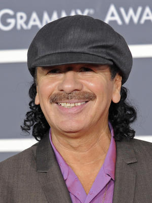 "FILE - In this Jan. 31, 2010 file photo, musician Carlos Santana arrives at the Grammy Awards in Los Angeles. The Grammy-winning superstar has an agreement with Little, Brown and Co. to tell his life story. The publisher, a division of Hachette Book Group, announced Thursday, Sept. 13, 2012, that the book is scheduled for release in 2014. It doesn't yet have a title. The 65-year-old Santana is expected to tell stories of such friends and peers as Miles Davis, Eric Clapton and Herbie Hancock. Little, Brown and Co. has a strong history of rock star memoirs: Two years ago, it published Keith Richard's ""Life."" Santana has won 15 Grammys and is best known for the album ""Supernatural,"" which has sold more than 25 million copies.  (AP Photo/Chris Pizzello, file)"