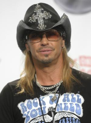 FILE - In this May 22, 2011 file photo, singer and musician Bret Michaels arrives at the 2011 Billboard Music Awards in Las Vegas. A federal judge in Los Angeles has moved Michaels' lawsuit over an injury at the 2009 Tony Awards to a New York federal court. (AP Photo/Dan Steinberg, file)