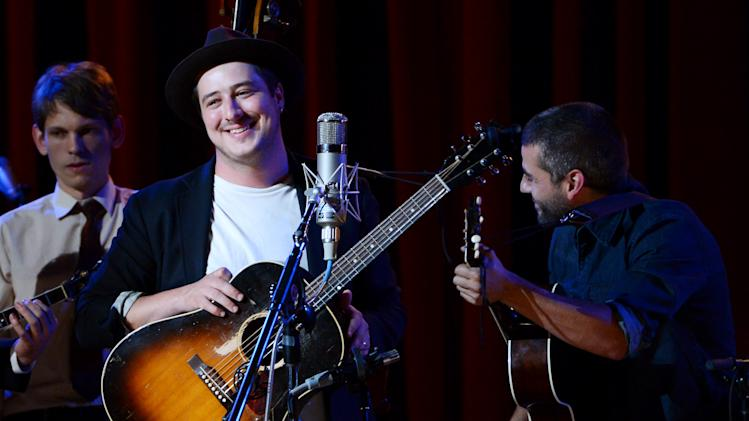 "Musicians Marcus Mumford, left, and Oscar Isaac perform together during ""Another Day, Another Time: Celebrating the Music of Inside Llewyn Davis"" at The Town Hall on Sunday, Sept. 29, 2013 in New York. (Photo by Evan Agostini/Invision/AP)"