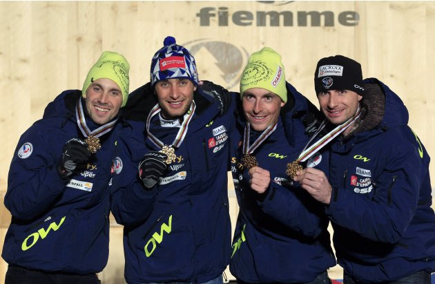 France team members celebrate on the podium after winning the gold medal in the Nordic Combined Team Gundersen competition at the Nordic Ski World Championships in Cavalese