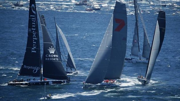 The field of yachts including Wild Oats XI (C), Beau Geste (R) and Perpetual Loyal (L) tack out of Sydney Harbour (Reuters)