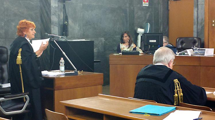 Prosecutor Ilda Boccassini, left, makes her closing arguments as former Premier Silvio Berlusconi's lawyer Piero Longo sits at right during a hearing in Berlusconi's sex-for-hire trial, in Milan, Italy, Monday, May 13, 2013. Berlusconi is accused of paying for sex with an underage Moroccan prostitute at a lavish party he hosted while he was premier and then trying to cover it up. The sensational trial reopened just days after Berlusconi's four-year sentence for tax fraud was confirmed by an appeals court, a damaging verdict that nonetheless cannot be enforced until all appeals are exhausted. Boccassini, who is continuing final arguments opened by a colleague in early March, will wrap with sentencing demands later Monday. Barring delays, a verdict could come by the end of the month. (AP Photo/Antonio Calanni)