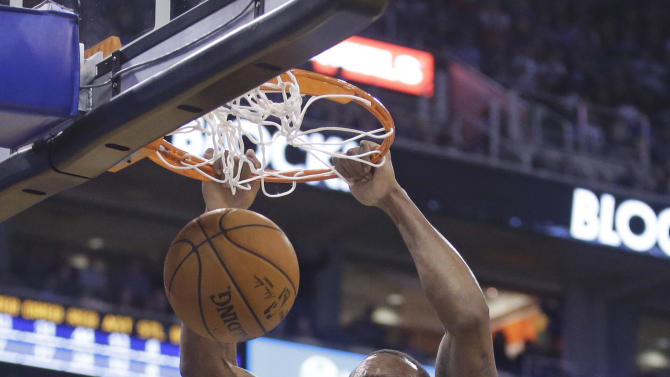 Utah Jazz forward Trevor Booker (33) dunks in front of Golden State Warriors guard Leandro Barbosa (19) during the third quarter of an NBA basketball game Friday, Jan. 30, 2015, in Salt Lake City. The Jazz won 110-100. (AP Photo/Rick Bowmer)