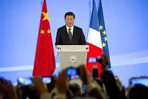 Chinese President Xi Jinping delivers a speech to mark fifty years of diplomatic relations between France and China at the French Foreign Ministry in Paris