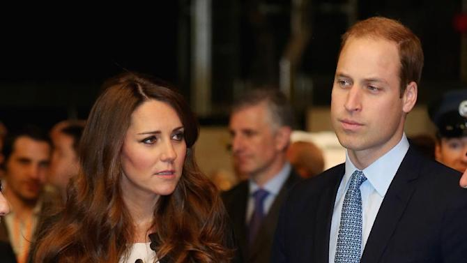 """Britain's Kate the Duchess of Cambridge with her husband Prince William, right, and his brother Prince Harry, not pictured, attend the inauguration of """"Warner Bros. Studios Leavesden"""" near Watford, approximately 18 miles north west of central London, Friday, April 26, 2013. As well as attending the inauguration Friday at the former World War II airfield site, the royals will undertake a tour of Warner Bros. """"Studio Tour London - The Making of Harry Potter"""", where they will view props, costumes and models from the Harry Potter film series. (AP Photo/Chris Jackson, Pool)"""