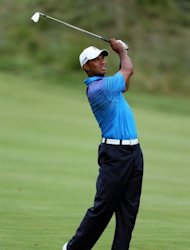 Tiger Woods hits an approach on the 15th hole during the second round of the Deutsche Bank Championship at TPC Boston in Norton, Massachusetts
