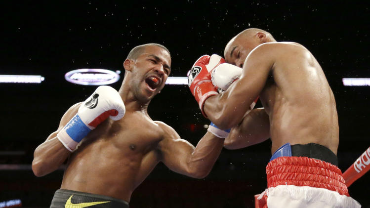 Rances Barthelemy, left, fights Argenis Mendez on Friday, July 11, 2014, during a boxing match begun late Thursday in Miami. Barthelemy defeated Mendez. (AP Photo/Wilfredo Lee)