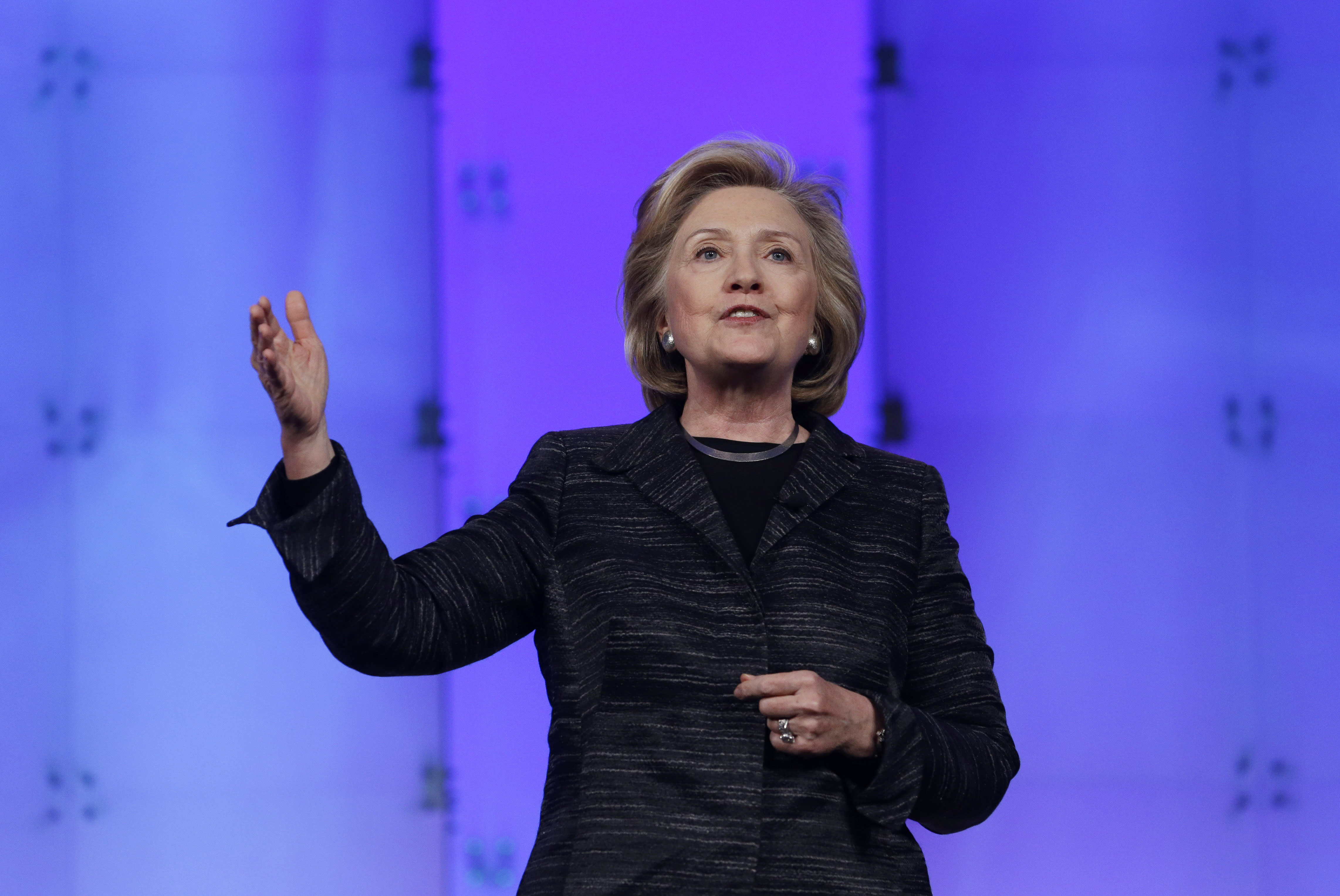 Clinton says she would push for inclusive problem-solving