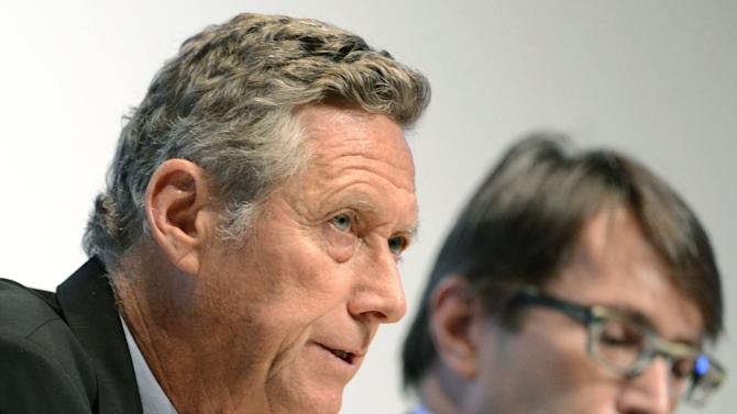 """Olivier Blanchard, left, chief economist of the International Monetary Fund, speaks during a press briefing on a quarterly update of its World Economic Outlook in Tokyo Tuesday, Oct. 9, 2012. Plagued by uncertainty and fresh setbacks, the world economy has weakened further and will grow more slowly over the next year, the IMF says in its latest forecast. """"Low growth and uncertainty in advanced economies are affecting emerging market and developing economies through both trade and financial channels, adding to homegrown weaknesses,"""" Blanchard said in a statement. (AP Photo/Kyodo News) JAPAN OUT, MANDATORY CREDIT, NO LICENSING IN CHINA, FRANCE, HONG KONG, JAPAN AND SOUTH KOREA"""