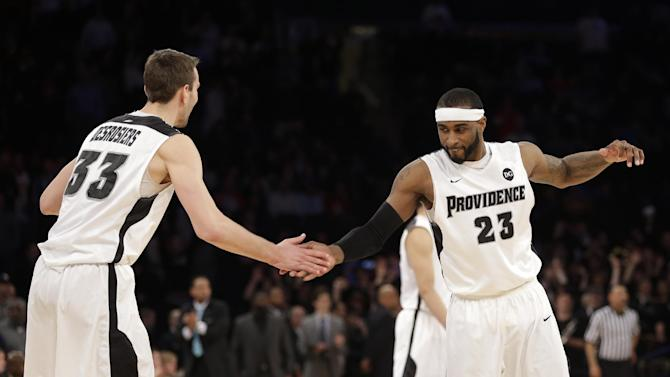 Providence's LaDontae Henton, right, and Carson Desrosiers celebrate during the second half of an NCAA college basketball game against St. John's in the quarterfinals of the Big East Conference tournament at Madison Square Garden, Thursday, March 13, 2014 in New York. Providence defeated St. John's 79-74