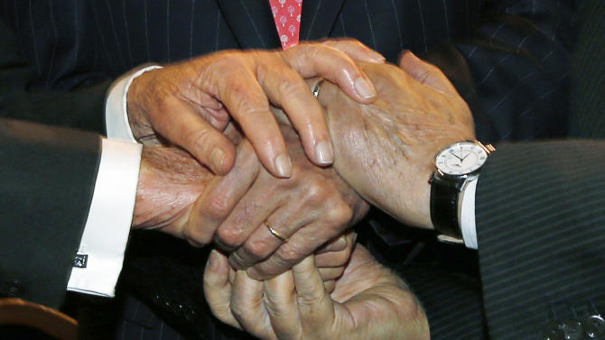 U.S. Secretary of State John Kerry, Israeli President Shimon Peres, left, and Palestinian President Mahmoud Abbas, right, shake hands together during the World Economic Forum on the Middle East and North Africa at the King Hussein Convention Center at the Dead Sea in Jordan Sunday May 26, 2013.  (AP Photo/Pool, Jim Young)