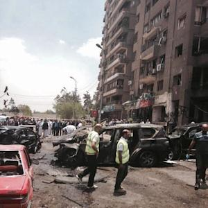 Security personnel inspect damages after a bomb attack…