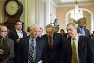 <p>Majority Leader Harry Reid (C) is flanked by Sen. Ben Cardin (L) and Sen. Dick Durbin (R) as they leave a caucus meeting and head toward the Senate floor in Washington on December 28, 2012. With the clock ticking toward a New Year's time bomb of huge tax increases and spending cuts, US lawmakers worked feverishly Saturday to keep America from tumbling off the so-called fiscal cliff.</p>