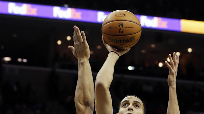 Oklahoma City Thunder's Kevin Martin (23) shoots over Memphis Grizzlies' Jerryd Bayless (7) during the first half of an NBA basketball game in Memphis, Tenn., Wednesday, March 20, 2013. (AP Photo/Danny Johnston)