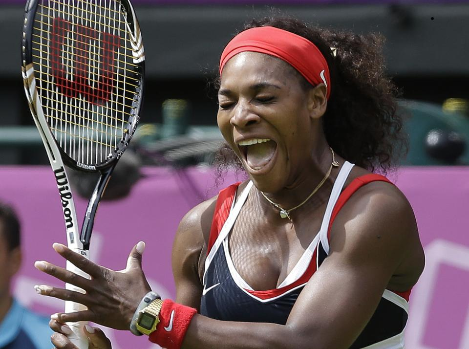 Serena Williams of the United States screams as she competes against Jelena Jankovic of Serbia during a first round match at the All England Lawn Tennis Club in Wimbledon, London at the 2012 Summer Olympics, Saturday, July 28, 2012. (AP Photo/Elise Amendola)