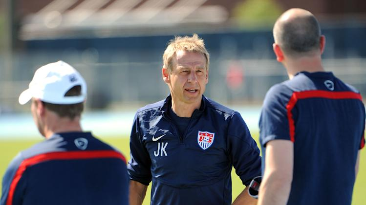U.S.head coach Jurgen Klinsmann talks with his assistant coaches before the practice begins, Wednesday, June 4, 2014 in Jacksonville, Fla.. The team was practicing in advance of Saturday's friendly match against Nigeria, the last before the World Cup matches in Brazil. (AP Photo/The Florida Times-Union, Bob Mack)