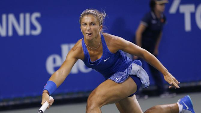 Sara Errani of Italy returns a shot to Marina Erakovic of New Zealand during their first round match of the Japan Pan Pacific Open tennis tournament in Tokyo,Tuesday, Sept. 16, 2014. (AP Photo/Shizuo Kambayashi)