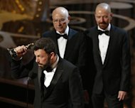 "Director and producer Ben Affleck accepts the award for best motion picture for ""Argo"" as actors Alan Arkin (2L) and Bryan Cranston look on at the 85th Academy Awards in Hollywood, California February 24, 2013. REUTERS/Mario Anzuoni"