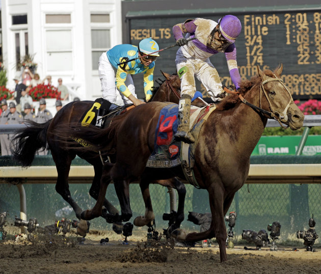 Jockey Mario Gutierrez rides I'll Have Another to victory past Bodemeister ridden by Mike Smith (6) to victory in the 138th Kentucky Derby horse race at Churchill Downs Saturday, May 5, 2012, in Louis